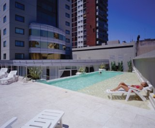 Hotel abasto plaza for Piscina de abastos